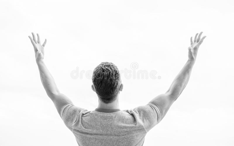 Future concept. Looking forward in future. Strong muscular body feeling powerful rear view. Successful athlete. Victory royalty free stock photos