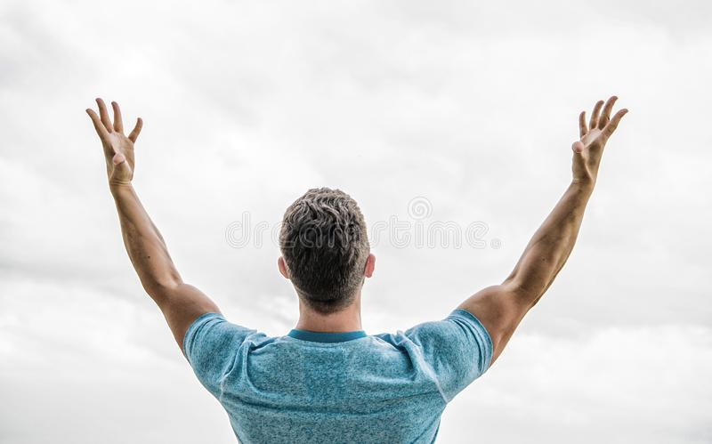 Future concept. Looking forward in future. Strong muscular body feeling powerful rear view. Successful athlete. Victory royalty free stock photo