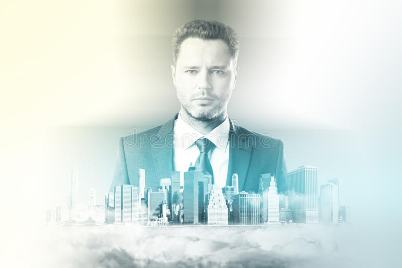 Future concept. Portrait of handsome caucasian businessperson in suit on city background. Double exposure. Future concept royalty free stock photo