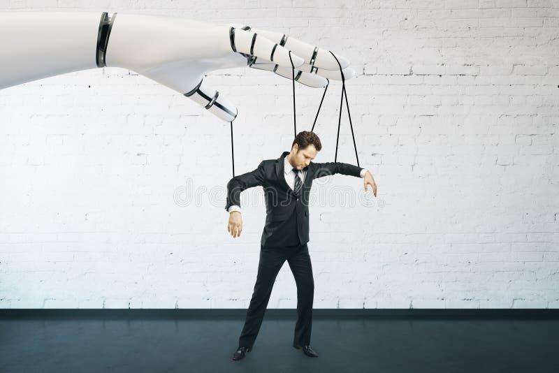 Future concept. Robotic hand manipulating businessman on brick background. Future concept royalty free stock photo