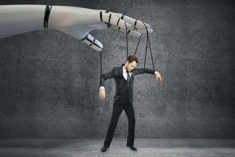 Future concept. Robotic hand manipulating businessman on concrete background. Future concept stock image