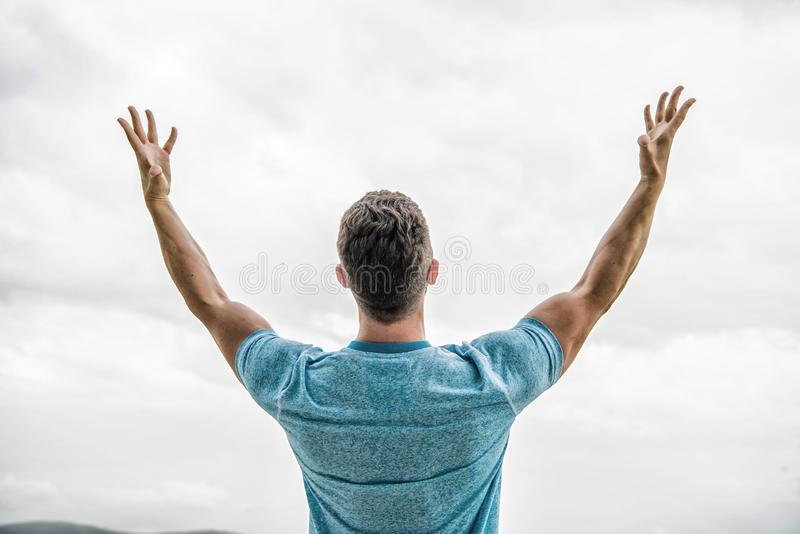 Future concept. Strong muscular body feeling powerful rear view. Successful athlete. Victory and success. Champion stock images