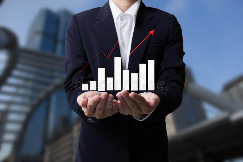 Future of financial business concept,Businessman with finance symbols coming and city backgrounds. Future of financial business concept,Businessman with finance stock photos