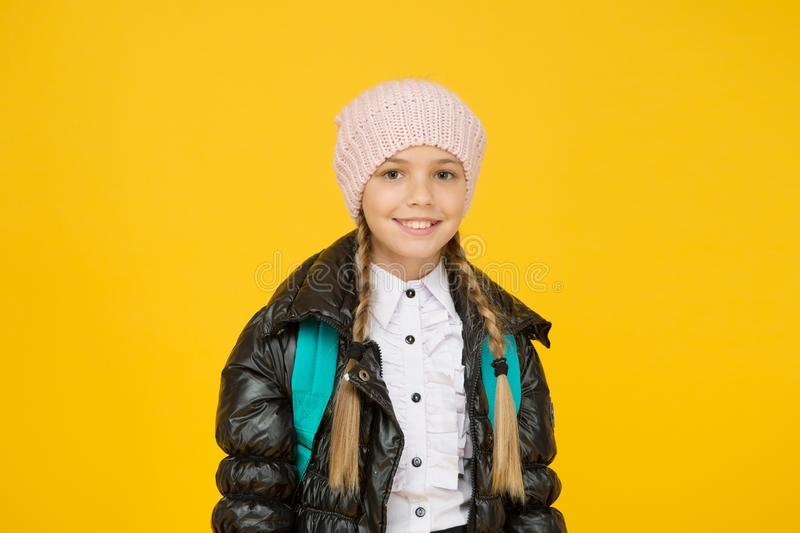 Future focused learning. Happy little schoolgirl smiling on yellow background. Small child in autumn fashion. Going royalty free stock images
