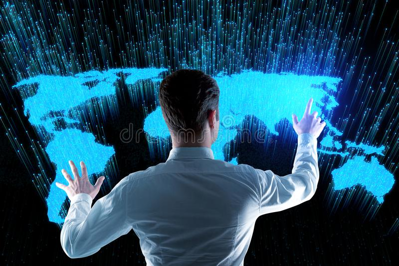 Future and global business concept. Back view of businessman using abstract glowing digital map hologram on black background. Future and global business concept stock images