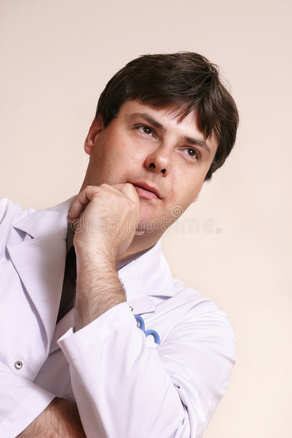 Future of Medicine. Young doctor looks ahead royalty free stock photo