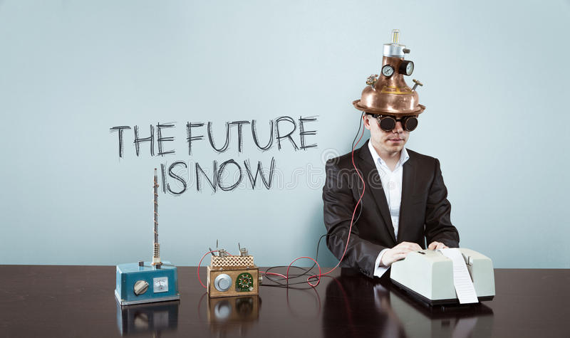 The future is now text with vintage businessman at office. The future is now text with vintage businessman and calculator at office royalty free stock images