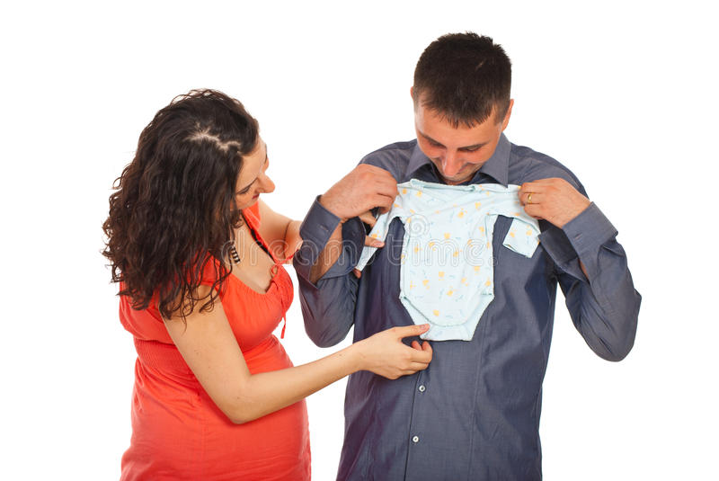 Future parents holding baby cloth stock image
