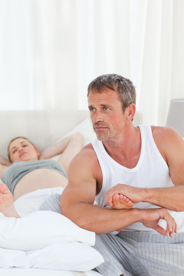 Download Future Parents On Their Bed Stock Photo - Image of female, mother: 18107594