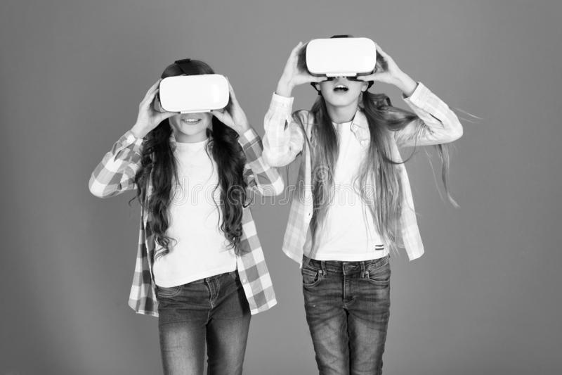 Future is present. Cyber space and virtual gaming. Virtual reality technology. Discover virtual reality. Kids girls play. Virtual reality game. Friends interact stock image
