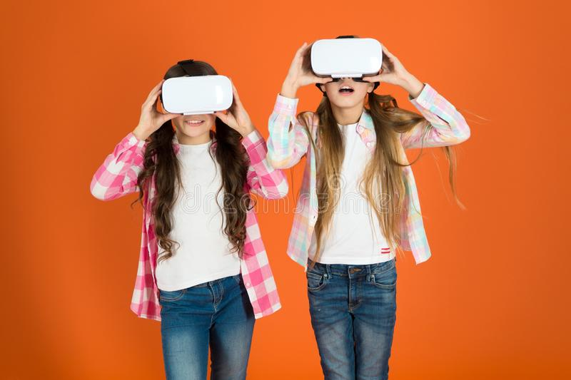 Future is present. Cyber space and virtual gaming. Virtual reality technology. Discover virtual reality. Kids girls play. Virtual reality game. Friends interact royalty free stock images