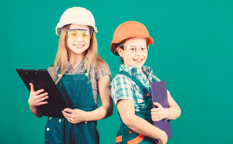 Future profession. Child care development. Builder engineer architect. Kid worker in hard hat. Tools to improve yourself. Repair. small girls repairing stock images