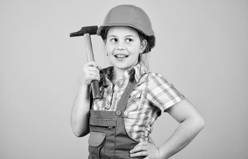 Future profession. Child care development. Builder engineer architect. Kid worker in hard hat. Tools to improve yourself. Repair. small girl repairing with stock image