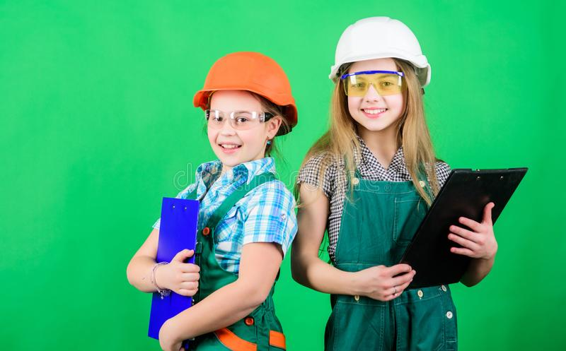 Future profession. Child care development. Builder engineer architect. Kid worker in hard hat. Tools to improve yourself. Repair. small girls repairing royalty free stock photos