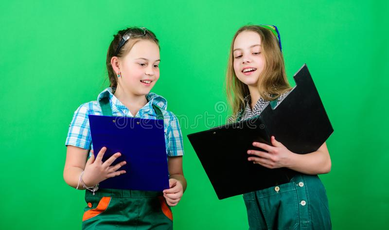 Future profession. Kids girls planning renovation. Initiative children girls provide renovation their room green stock photo