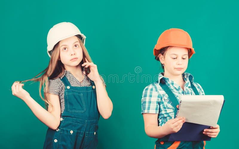 Future profession. Kids girls planning renovation. Initiative children girls provide renovation their room green royalty free stock photo