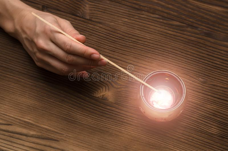 Future reading. Fortune teller concept. Divination concept. Fortune teller lights the candle on wooden table. Divination concept royalty free stock image
