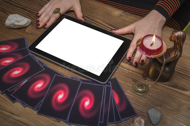 Future reading online template. Tarot cards and tablet computer with blank screen. Online future reading concept. Tarot cards and tablet computer with blank stock photo