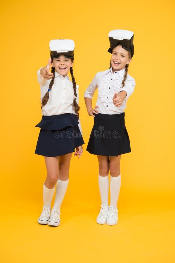 Future school education. Small children wear wireless VR glasses. best friends. Happy kids use modern technology. Digital future and innovation. Future stock photos