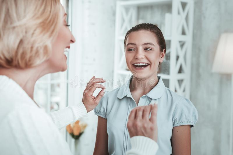 Happy delighted girl wanting to become a singer stock image