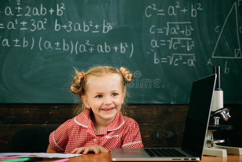 Future student answer at chalkboard. Little girl learning for future examination royalty free stock image