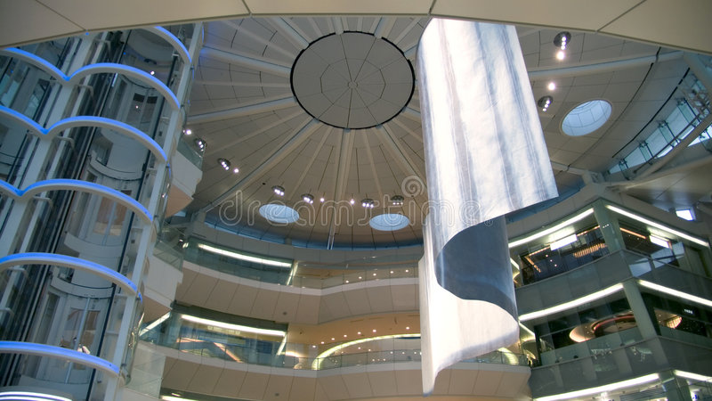 Futuristic atrium. Abstract futuristic public hall interior, view from below to spherical roof royalty free stock photo
