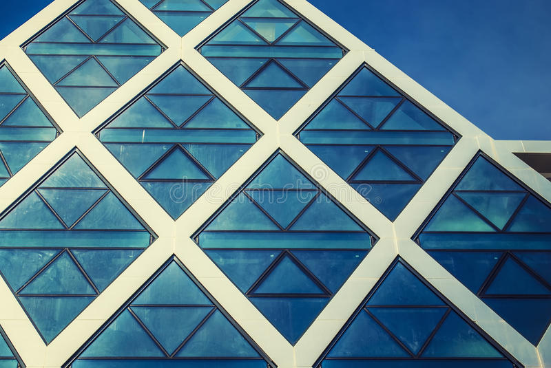 Futuristic building. With mirrored facade in blue royalty free stock images