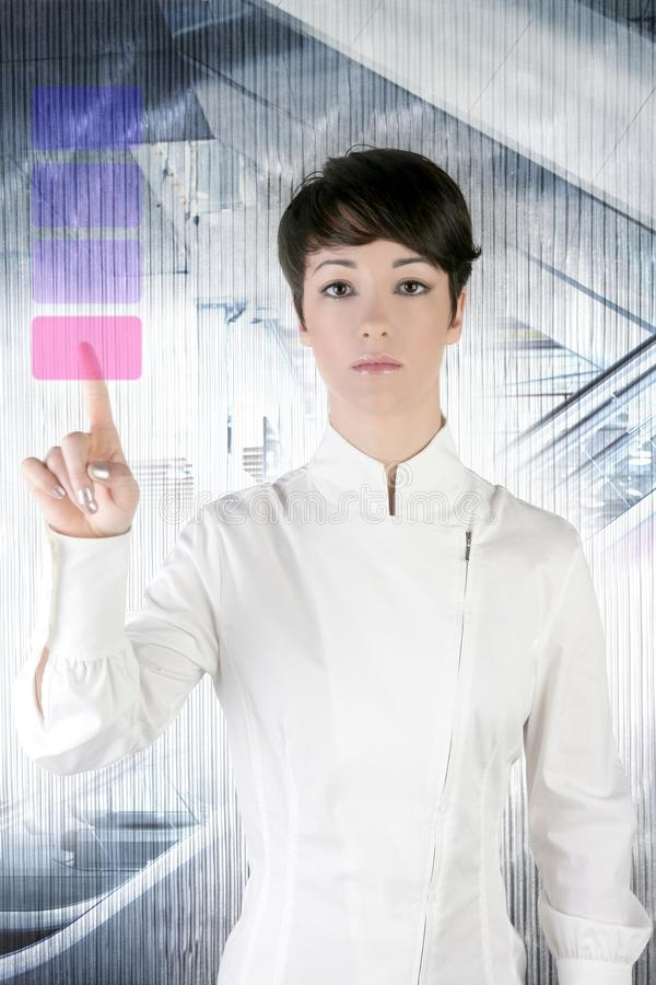 Futuristic businesswoman office finger touch pad. Futuristic businesswoman finger touch pad on modern office stock photo