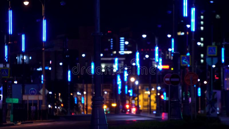 Futuristic city highway lights at night. Stock footage. Modern lighting with lanterns roads of metropolis at night royalty free stock image