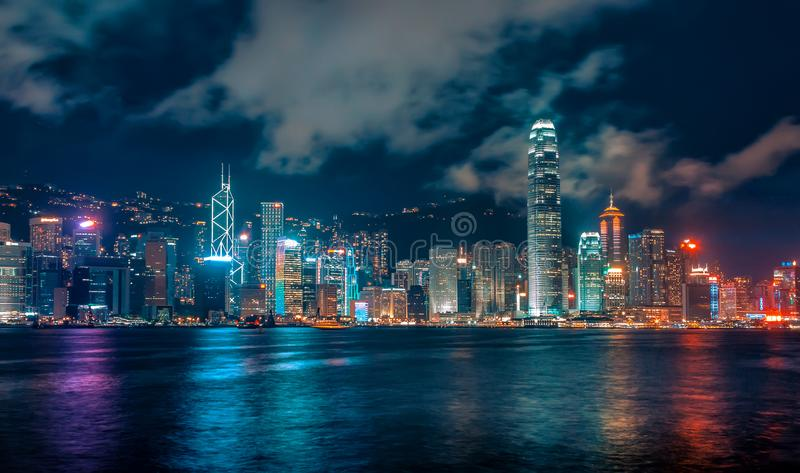 Futuristic City Skyline at Night with Colourful Lights and Reflections, Hong Kong stock photo