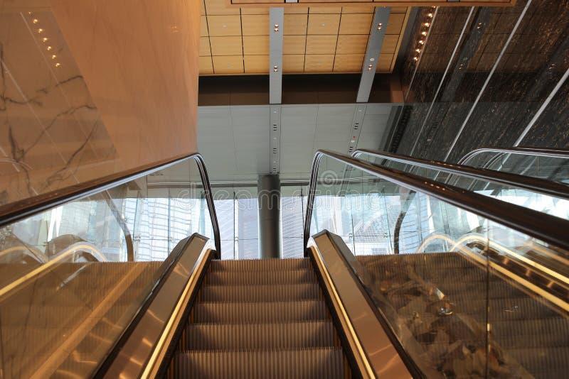 Futuristic escalator in modern office. The futuristic escalator in modern office hk stock photos