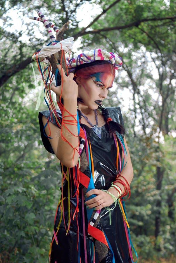 Futuristic girl in black PVC dress royalty free stock photography
