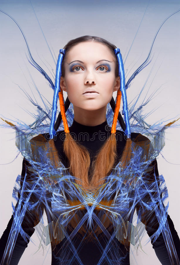 Futuristic girl with blue and orange energy flows. Art concept stock photos