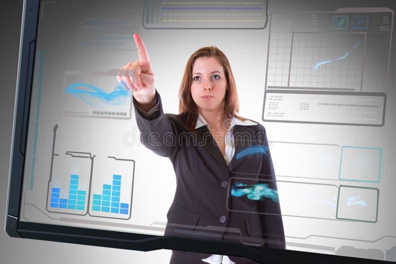Futuristic ha kontakt avskärmer röra av affärskvinnan royaltyfri foto