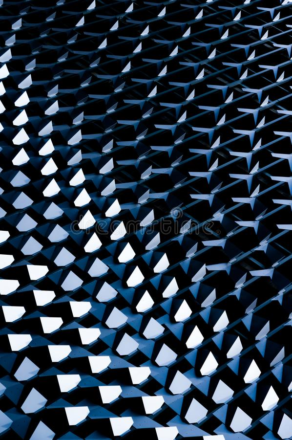 Futuristic looking facade of modern building with metal elements stock image