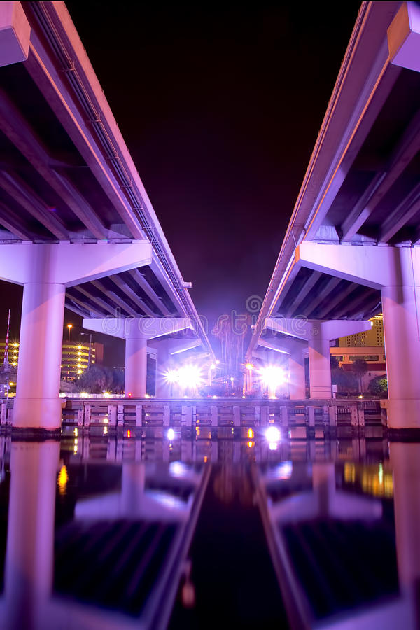 Crosstown Expressway in Tampa. Under the Crosstown Expressway in Tampa, lit up purple at night - giving it a futuristic look stock photos