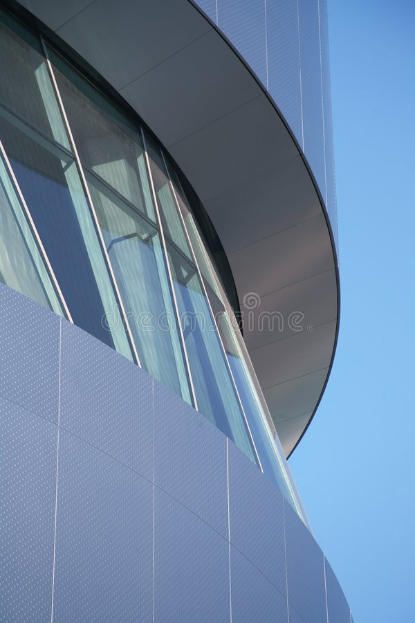 Futuristic modern building detail. Nice modern building detail surrounded by blue sky stock image