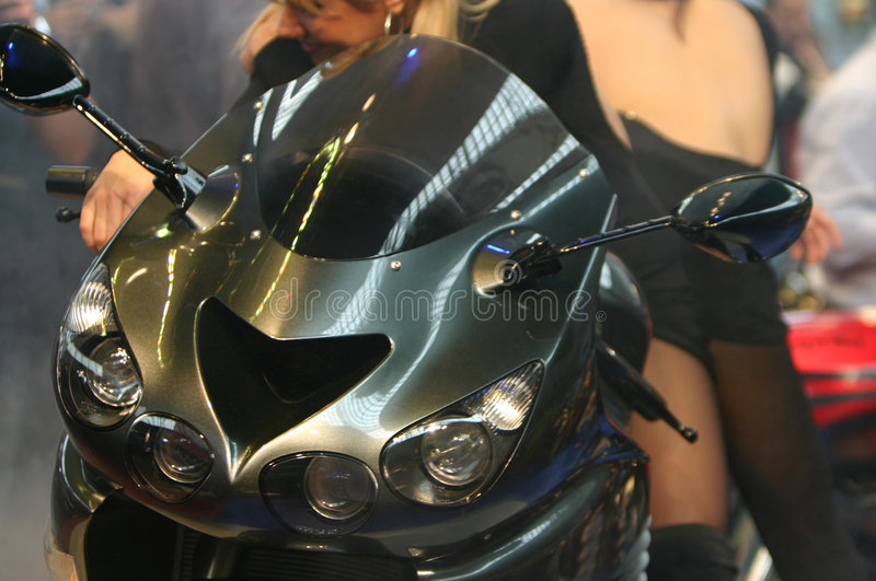 Futuristic motorcycle. Dream motorcycle with dream babes royalty free stock photos