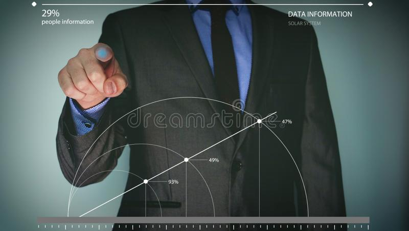 Futuristic portrait of a businessman uses a career chart, a hologram, a diagram, in a suit, makes a finger click. Concept: future, stock images
