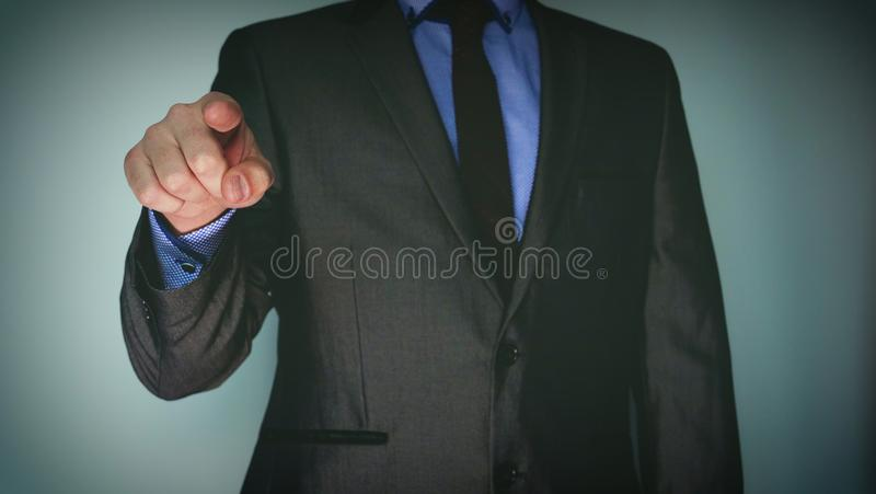 Futuristic portrait of a businessman uses a career chart, a hologram, a diagram, in a suit, makes a finger click. Concept: future, royalty free stock photo