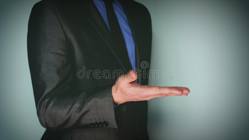 Futuristic portrait of a businessman uses a career chart, a hologram, a diagram, in a suit, makes a finger click. Concept: future, stock photos
