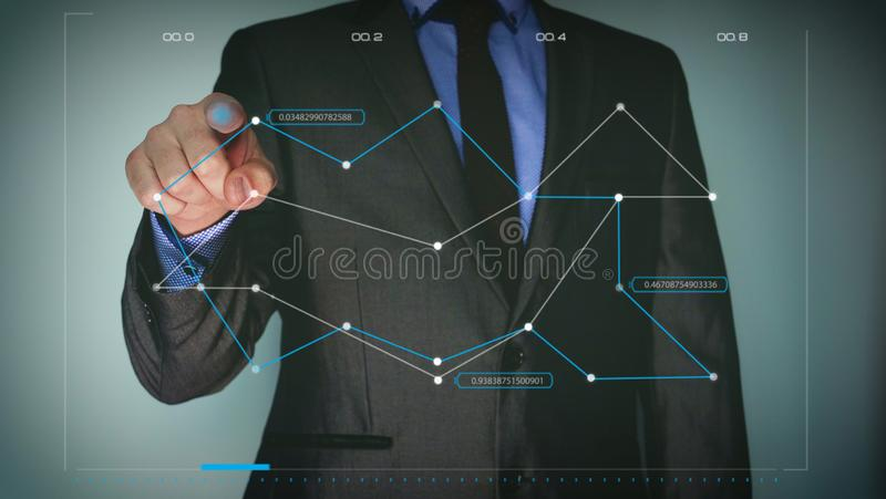 Futuristic portrait of a businessman uses a career chart, a hologram, a diagram, in a suit, makes a finger click. Concept: future, stock image