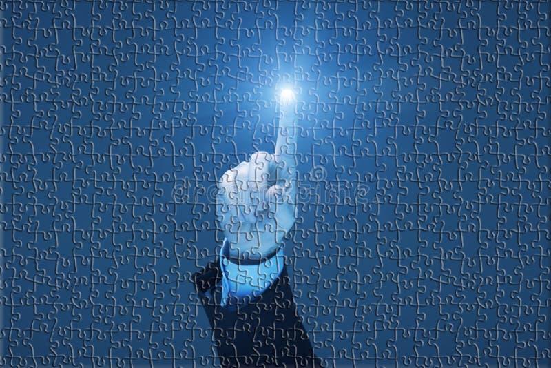 Futuristic Puzzle. Businessman using a touch screen on futuristic jigsaw puzzle stock photo