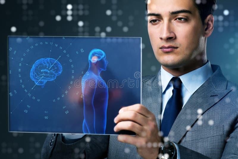 The futuristic remote diagnostics concept with businessman stock images