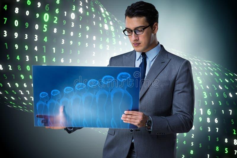 The futuristic remote diagnostics concept with businessman stock image