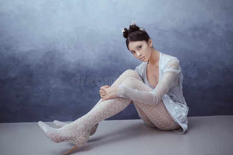 Futuristic young asian woman. stock image