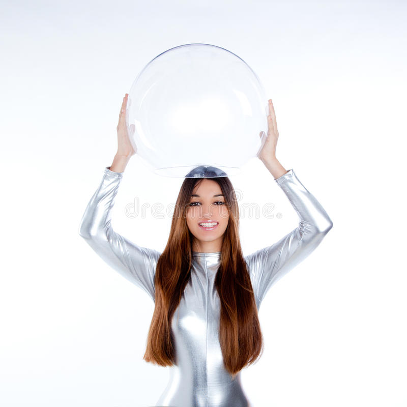 Futuristic silver woman holding glass helmet royalty free stock photography