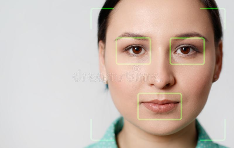 Futuristic and technological scanning of the face of a beautiful woman for facial recognition and scanned person. It can serve to. Ensure personal safety royalty free stock image