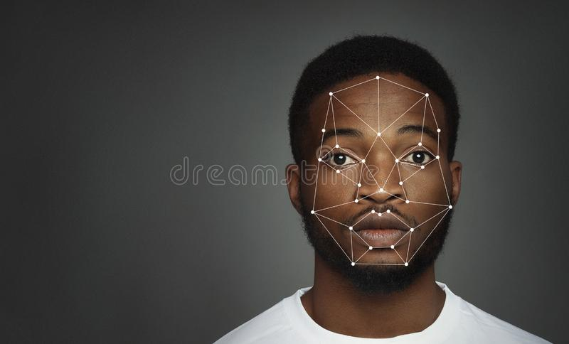 Futuristic and technological scanning of face for facial recognition. Futuristic and technological scanning of african-american man face, free space stock photos