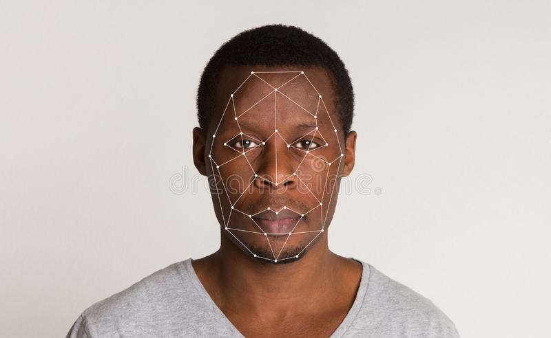 Futuristic and technological scanning of face for facial recognition. Future technologies and security. Scanning of african-american man face for biometric royalty free stock photography